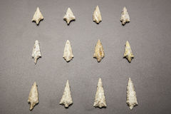 Neolithic stone arrowheads. Madrid, Spain - February 24, 2017: neolithic stone arrowheads, at National Archeological  Museum of Madrid Royalty Free Stock Image