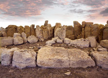 Neolithic temple, Malta. Ruins of neolithic temple at Mnajdra, Malta, with dramatic sky Royalty Free Stock Image