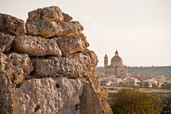 Neolithic wall with Ta' Pinu Basilica in Gozo. Remains of the neolithic walls of the temple of Ggantia on the island of Gozo in Malta Stock Photography