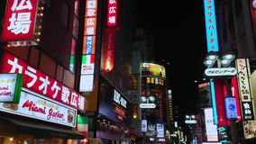 Neon advertising and city lights in Shibuya - a crowded area at night - TOKYO / JAPAN - JUNE 12, 2018. Neon advertising and city lights in Shibuya - a crowded stock video