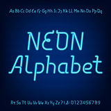 Neon alphabet font. Blue neon lowercase, uppercase letters and numbers on a dark background Stock Photography