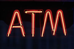 Neon ATM Sign. Red neon ATM sign in store window Stock Photos