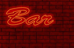 Neon Bar. Neon signboard Bar on a background of a brick wall royalty free stock images