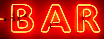 Neon Bar Sign. Red and yellow neon bar sign Stock Image