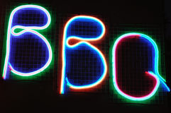 Neon bbq sign. Color neon BBQ sign on a black background royalty free stock photos