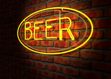 Neon Beer Sign on A Face Brick Wall. An illuminated orange neon sign with the word beer on it mounted on a brick wall royalty free stock image