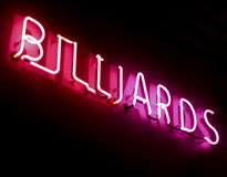 Neon billiards sign. Red and pink neon billiards sign Stock Photo