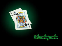 Neon Blackjack. Ace of Spades and King of Spades on a green background make a Blackjack spotlighted. The word Blackjack has a green neon effect applied Stock Photos