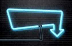 Neon blue arrow isolated on black brick wall Stock Image