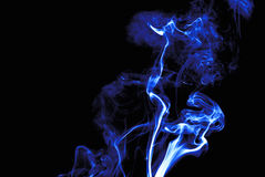 Neon blue smoke. Flow against back background Stock Images