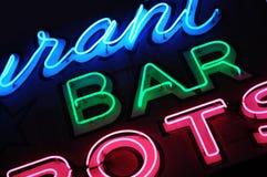 Neon bommar för undertecknar Arkivfoton