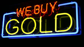 Neon WE BUY GOLD sign. Red, Blue and Yellow WE BUY GOLD Sign lights up the night Royalty Free Stock Images