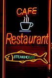 Neon cafe restaurant steakhouse. On wooden wall Stock Images
