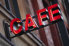 Neon cafe sign, restaurant building, night Stock Photos