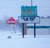 Neon car wash sign in snow storm. Royalty Free Stock Images