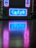 Neon cash sign. In an empty amusement park Royalty Free Stock Photography