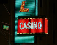 Neon Casino Sign. Bright and blinking neon and lights advertising a casino are shown Royalty Free Stock Images