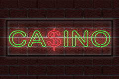 Neon casino sign. Illustration of a neon casino sign against a dark brick wall Stock Images