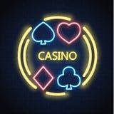 Vector neon casino poker card suit sign brick wall. Neon casino sign. Poker, blackjack card suits, spade diamond heart club. Gambling light lamp glowing singage Royalty Free Stock Image