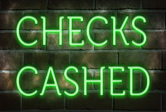 Neon CHECKS CASHED sign Stock Photo