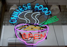 Neon Chinese Food Sign. A neon sign in a restaurant window advertises Chinese Food for sale within Royalty Free Stock Image