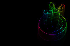 Neon Christmas toy on a black background with space for text. It remains to add text Royalty Free Stock Photography