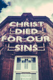 Neon Church Sign. A Neon Sign On An Old Building Saying Christ Died For Our Sins Stock Photo
