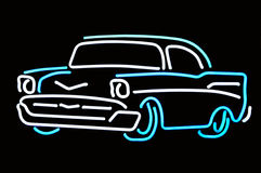 Neon Classic. Classy aqua and white neon 57 Chevy against black background Royalty Free Stock Photos
