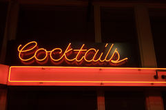 Neon cocktail light. A view of a neon sign advertising cocktails outside of a bar at night Royalty Free Stock Photo