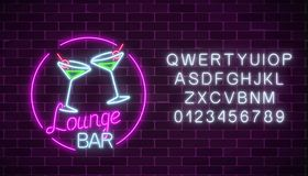 Neon cocktails lounge bar sign with alphabet. Glowing gas advertising with glasses of alcohol shake. Neon cocktails lounge bar sign with alphabet on dark brick Royalty Free Stock Images