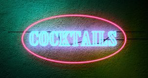 Neon cocktails sign outside tropical bar shows nightclub entrance - 4k