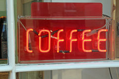 Neon coffee shop sign. Photo of a red neon coffee sign in shop window Stock Photo