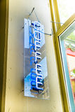 Neon coffee sign. Blue neon coffee sign displayed in window Stock Images
