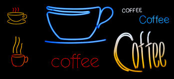 Neon coffee signs and coffee cups. Various neon signs - different neon coffee cups and the word coffee in different colors and neon fonts Stock Photo