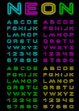 Neon color font. Vector letters and figures with effect neon Stock Image
