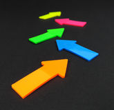 Neon colored arrows Stock Photo