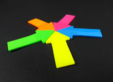 Neon colored arrows, teamwork Stock Photo