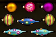 Neon Colored Christmas Decorations. Against a Flat Black Background royalty free stock image