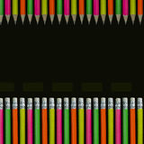 Neon colored pencils. All in a line isolated on black Royalty Free Stock Photo
