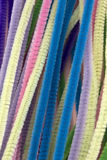 Neon colored pipe cleaners. This is a photograph of Pastel colored pipe cleaners Royalty Free Stock Image