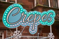 Neon crepes sign. Neon sign over a stall selling crepes Stock Photo