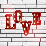 Neon 3d word Love with lights. Royalty Free Stock Photography