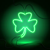 Neon dark green clover. Green neon sign, Shamrock Clover on dark background. Design element for St Patrick`s Day. Ready for your design, greeting card, banner Royalty Free Stock Images