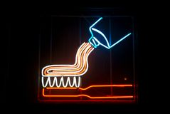 Neon Dentist. Neon toothpaste and toothbrush. Dentist signage Stock Photo