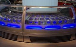 Neon display. Modern neon glass food display Royalty Free Stock Image