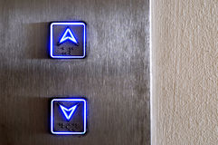 Neon elevator controls, up, down, close up Royalty Free Stock Photography
