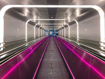 Neon escalator in Train Station Oslo Norway. Norway, Oslo - JUNE 08, 2017: Neon escalator tunnel in Train Station Stock Photography