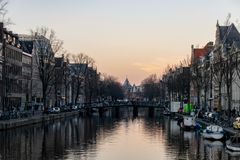 Neon evening lights reflected in the Canals of Amsterdam, The Netherlands royalty free stock photography