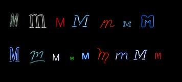 neon för samlingsbokstav M Arkivbild