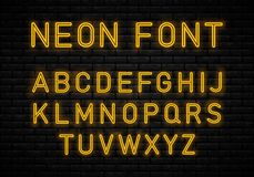 Light Neon Font. Neon font on brick wall background. Glowing vector linear neon typefaces, alphabet, letters, font, typography. Light Neon Font Alphabet Vector royalty free illustration